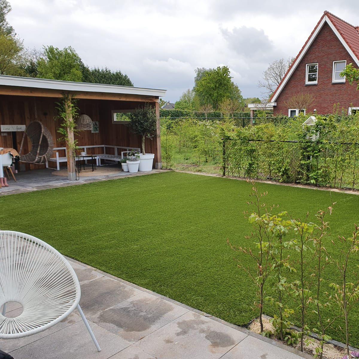 tivoli kunstgras tuin met overkapping